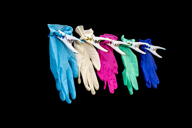 hanging gloves representing covide secure teams